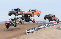Nov. 6, 2010; Las Vegas, NV USA; LOORRS pro four unlimited drivers Kyle Leduc (99) leads the field over a jump during round 13 at the Las Vegas Motor Speedway short course. Mandatory Credit: Mark J. Rebilas-