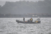 BNPS.co.uk (01202 558833)<br /> Pic: MaxWillcock/BNPS<br /> Date taken: 27/06/2021<br /> <br /> Pictured: A police boat searching the water.<br /> <br /> A body has today been found in the search for a heroic teenager who is feared to have drowned after rescuing his nieces and nephews from a ferocious riptide.<br /> <br /> Callum Osborne-Ward, 18, was swept away in front of his family moments after lifting the last of a group of about 13 children into a rescue boat.<br /> <br /> The youngsters had been swimming and playing in relatively shallow water close to Black Bridge at Rockley Point in Poole Harbour, Dorset, when they were dragged away by the fast flowing tide at about 4pm on Monday.