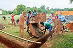 Auroville, India - April 2021: Human Unity in Covid Time. Construction work to build a new community.