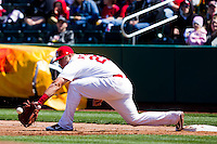 Matthew Adams (25) of the Springfield Cardinals scoops the ball on a low throw to first during a game against the Frisco RoughRiders on April 16, 2011 at Hammons Field in Springfield, Missouri.  Photo By David Welker/Four Seam Images