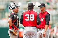 Kannapolis Intimidators pitching coach Jose Bautista #38 has a chat with pitcher Brandon Parrent #30 and catcher Martin Medina #18 during the game against the Greensboro Grasshoppers at NewBridge Bank Park on May 16, 2012 in Greensboro, North Carolina.  The Grasshoppers defeated the Intimidators 10-8 in 11 innings.  (Brian Westerholt/Four Seam Images)