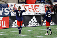 20th November 2020; Foxborough, MA, USA;  New England Revolution forward Gustavo Bou celebrates his winner with New England Revolution forward Carles Gil (22) during the MLS Cup Play-In game between the New England Revolution and the Montreal Impact