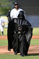 Darth Vader throws out a ceremonial first pitch in front of CC Sabathia before a Tampa Yankees game against the Dunedin Blue Jays on June 28, 2014 at George M. Steinbrenner Field in Tampa, Florida.  Tampa defeated Dunedin 5-2.  (Mike Janes/Four Seam Images)