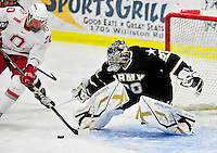 2 January 2011: Army Black Knight goaltender Ryan Leets, a Sophomore from Kentwood, MI, stops Ohio State University Buckeye forward C.J. Severyn, a Senior from  Beaver, PA, at Gutterson Fieldhouse in Burlington, Vermont. The Buckeyes defeated the Black Knights 5-3 to win the 2010-2011 Catamount Cup. Mandatory Credit: Ed Wolfstein Photo