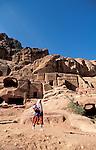 Jordan, Petra. A Bedouin woman in front of Nabatean tombs&#xA;<br />