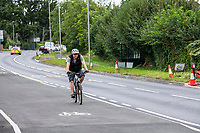 BNPS.co.uk (01202 558833)<br /> Pic: MaxWillcock/BNPS<br /> <br /> Pictured: A cyclist using the cycle lane.<br /> <br /> A cycle lane which is believed to be one of Britain's widest has been slammed by road users who are bemused by its size.<br /> <br /> Despite measuring over half as wide as the adjacent road, cyclists have still been spotted using the carriageway instead of the cycle lane.<br /> <br /> The cycle way is a whopping 11ft wide, 2ft wider than the vehicle lane which locals say is frequented by heavy goods and emergency vehicles.<br /> <br /> Residents on Wimborne Road West in Wimborne, Dorset, were exasperated when they woke one morning to the 'cycle highway' as it has been dubbed by the local council.<br /> <br /> It is part of a major £102 million scheme to make travel more sustainable and reduce congestion across the county but they argue it could have the opposite effect by obstructing traffic.