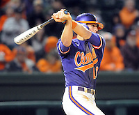 Shortstop Brad Miller (13) of the Clemson Tigers hits during a game against the South Carolina Gamecocks on Tuesday, March 8, 2011, at Fluor Field in Greenville, S.C.  Photo by Tom Priddy / Four Seam Images.