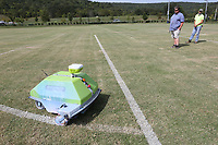 Marshall Wood (left) and Jose Hernandez, both with the city of Fayetteville's Parks and Recreation Department, monitor the robotic line painter, Turf Tank, as it is paints Monday, September 14, 2020, for on one of the soccer fields at Kessler Mountain Regional Park in Fayetteville. The robot is currently being used to outline 42 soccer fields that are within the city at Walker, Lewis and Kessler Mountain Regional Park. Check out nwaonline.com/200915Daily/ and nwadg.com/photos for a photo gallery.<br /> (NWA Democrat-Gazette/David Gottschalk)