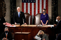 Speaker of the United States House of Representatives Nancy Pelosi (Democrat of California), and US Vice President Mike Pence officiate at a joint session of the House and Senate convenes to confirm the Electoral College votes cast in November's election, at the Capitol in Washington, Wednesday, Jan. 6, 2021. <br /> Credit: J. Scott Applewhite / Pool via CNP/AdMedia