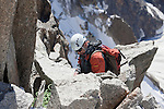 Mountain climber coming off of Mont-Blanc at Aiguille du Midi, Chamonix-Mont-Blanc, France
