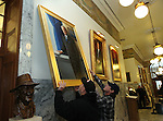 Buildings and grounds workers Bob Webb, left, and Mike Harasha hang the official portrait of Gov. Jim Gibbons in the Capitol in Carson City, Nev. on Friday, Dec. 17, 2010. .Photo by Cathleen Allison