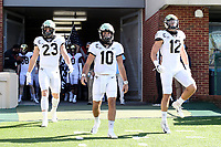 CHAPEL HILL, NC - NOVEMBER 14: Game captains Brandon Chapman #23, Sam Hartman #10, and Luke Masterson #12 of Wake Forest lead their teammates onto the field before a game between Wake Forest and North Carolina at Kenan Memorial Stadium on November 14, 2020 in Chapel Hill, North Carolina.