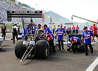 Jul. 23, 2011; Morrison, CO, USA: NHRA top fuel dragster crew members for driver Shawn Langdon during qualifying for the Mile High Nationals at Bandimere Speedway. Mandatory Credit: Mark J. Rebilas-