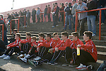 The Fleet football stafium. The Ebbsfleet Junior team watch a home game  Ebbsfleet v Tunbridge. Ebbsfleet Valley Kent UK 2014.