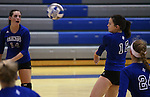 Marymount's Mallory Mitchell passes during a college volleyball match at Washington & Lee University Lexington, Vir., on Saturday, Oct. 5, 2013.<br /> Photo by Cathleen Allison