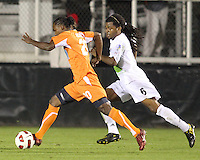 Gregory Richardson #20 Of the Carolina Railhawks bursts past Alexis Rivera #6 of the Puerto Rico Islanders during the second leg of the USSF-D2 championship match at WakeMed Soccer Park, in Cary, North Carolina on October 30 2010.