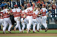 Louisville Cardinals celebrate the end of Game 10 of the NCAA College World Series against the Mississippi State Bulldogs on June 20, 2019 at TD Ameritrade Park in Omaha, Nebraska. Louisville defeated Mississippi State 4-3. (Andrew Woolley/Four Seam Images)
