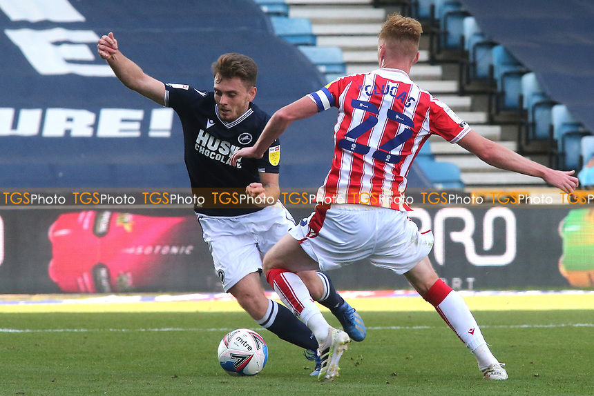 Ben Thompson of Millwall takes the ball past Stoke City's Sam Clucas  during Millwall vs Stoke City, Sky Bet EFL Championship Football at The Den on 12th September 2020