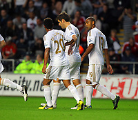 Pictured: Danny Graham of Swansea (C) with team mates Jonathan de Guzman (L) and Luke Moore (R) after his opening goal. Tuesday 28 August 2012<br /> Re: Capital One Cup game, Swansea City FC v Barnsley at the Liberty Stadium, south Wales.
