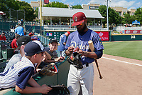 Frisco RoughRiders Eliezer Alvarez (10) signs autographs before a Texas League game against the Springfield Cardinals on May 5, 2019 at Dr Pepper Ballpark in Frisco, Texas.  (Mike Augustin/Four Seam Images)
