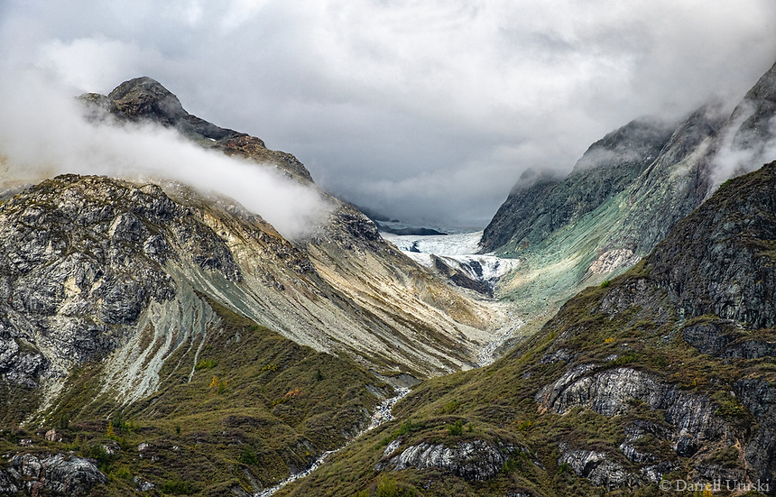 Fine Art Photograph of a misty cloud covered mountain range in Alaska.