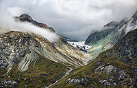 Fine Art Photograph of a misty cloud covered mountain range in Alaska.