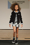 Model walks runway in an outfit by Vingino, during the petitePARADE Children's Club fashion show at the Jacob Javits Center in New York City, on January 9, 2016.