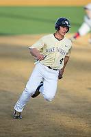 Stuart Fairchild (4) of the Wake Forest Demon Deacons hustles towards third base against the UConn Huskies at Wake Forest Baseball Park on March 17, 2015 in Winston-Salem, North Carolina.  The Demon Deacons defeated the Huskies 6-2.  (Brian Westerholt/Four Seam Images)
