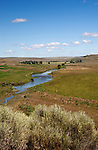 The Palouse River meanders through ranch land above famous Palouse Falls, near the town of Washtucna, Washington State.