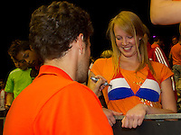 September 14, 2014, Netherlands, Amsterdam, Ziggo Dome, Davis Cup Netherlands-Croatia, Robin Haase (NED) signing autographs<br /> Photo: Tennisimages/Henk Koster