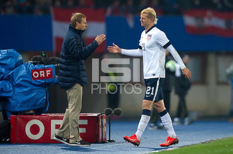 VIENNA, Austria - November 19, 2013: Manager Jurgen Klinsmann and Brek Shea during a 0-1 loss to host Austria during the international friendly match between Austria and the USA at Ernst-Happel-Stadium.
