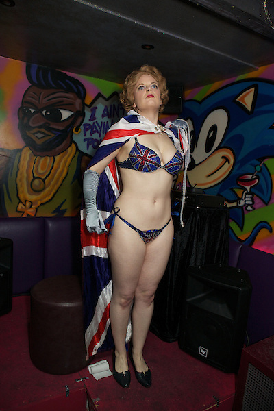 Margaret Thatcher impersonator Honey Wilde strips with Union flag at Maggies Nightclub in Chelsea