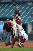 Boston College Eagles catcher Gian Martellini (2) catches a ball while running into pitcher Donovan Casey (30) during the game against the North Carolina Tar Heels in Game Five of the 2017 ACC Baseball Championship at Louisville Slugger Field on May 25, 2017 in Louisville, Kentucky. The Tar Heels defeated the Eagles 10-0 in a game called after 7 innings by the Mercy Rule. (Brian Westerholt/Four Seam Images)