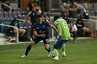 SAN JOSE, CA - OCTOBER 18: Cristian Espinoza #10 of the San Jose Earthquakes is defended by Nouhou #5 of the Seattle Sounders during a game between Seattle Sounders FC and San Jose Earthquakes at Earthquakes Stadium on October 18, 2020 in San Jose, California.