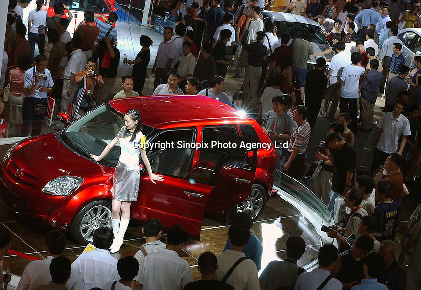 Attendants at the Auto China 2004 exhibition in Beijing, China..
