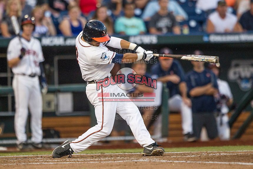 Virginia Cavaliers third baseman Kenny Towns (9) swings the bat against the Florida Gators in Game 13 of the NCAA College World Series on June 20, 2015 at TD Ameritrade Park in Omaha, Nebraska. The Cavaliers beat the Gators 5-4. (Andrew Woolley/Four Seam Images)