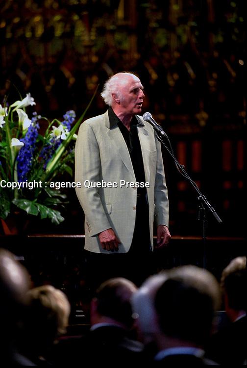 FILE PHOTO - Gilles Vigneault<br />  sing at<br /> Pierre Bourgault<br /> funerals, June 16, 2003 at <br /> Notre Dame<br /> Basilica<br /> <br /> <br /> PHOTO : Agence quebec Presse