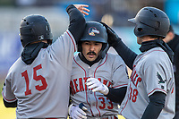 Great Lakes Loons second baseman Zac Ching (33) is greeted by his teammates after hitting a home run against the West Michigan Whitecaps at LMCU Ballpark on May 11, 2021 in Comstock Park, Michigan. (Andrew Woolley/Four Seam Images)