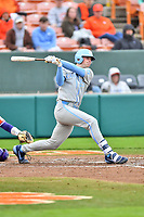 North Carolina Tar Heels designated hitter Jackson Hesterlee (26) swings at a pitch during a game against the Clemson Tigers at Doug Kingsmore Stadium on March 9, 2019 in Clemson, South Carolina. The Tigers defeated the Tar Heels 3-2 in game one of a double header. (Tony Farlow/Four Seam Images)