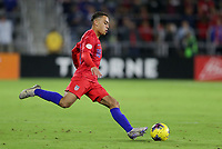ORLANDO, FL - NOVEMBER 15: Sergino Dest #18 of the United States sends a ball downfield during a game between Canada and USMNT at Exploria Stadium on November 15, 2019 in Orlando, Florida.