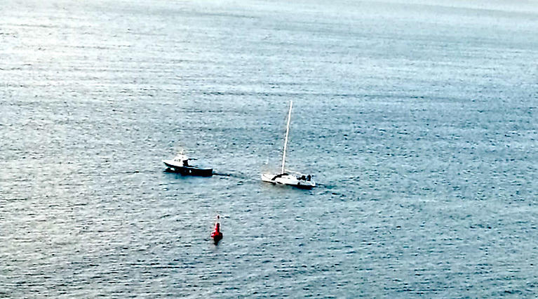 Jelly Baby under tow back to Crosshaven