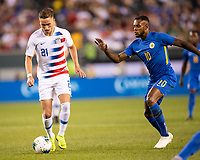 PHILADELPHIA, PA - JUNE 30: Tyler Boyd #21 is challenged by Leandro Bacuna #10 during a game between Curaçao and USMNT at Lincoln Financial Field on June 30, 2019 in Philadelphia, Pennsylvania.