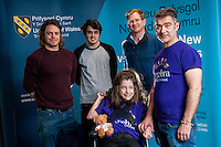 COPY BY TOM BEDFORD<br /> Sunday 26 June 2016<br /> Pictured: Poppy and Dad Rob together with the design team <br /> Re: A very special father-and-daughter team have tackled the Cardiff Triathlon.<br /> Poppy Jones, 11, who will be competing alongside dad Rob Jones, wants to win the event.<br /> And she's not going to let the fact that she has quadriplegic cerebral palsy , which means she can't sit, stand, roll or support herself, and chronic lung disease stop her.<br /> She will be by Rob's side every step of the way thanks to a cutting-edge wheelchair and boat – for Rob to push or pull – designed especially for the event, which sees participants take part in a swim across Cardiff Bay , a run and a bike ride.