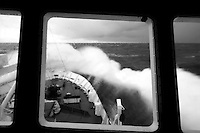 The icebreaker Professor Khromov pounds into the giant swell of the Southern Ocean