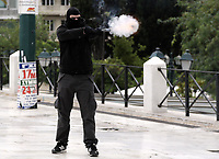 Pictured: A protester fires off a flare Wednesday 17 May 2017<br /> Re: Clashes between anti fourth memorandum protesters and riot police during 24 hour strike in Athens, Greece