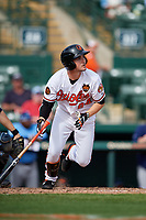 Baltimore Orioles first baseman Preston Palmeiro (84) follows through on a swing during a Grapefruit League Spring Training game against the Tampa Bay Rays on March 1, 2019 at Ed Smith Stadium in Sarasota, Florida.  Rays defeated the Orioles 10-5.  (Mike Janes/Four Seam Images)
