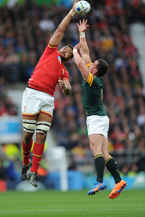 Taulupe Faletau of Wales outjumps Jesse Kriel of South Africa during Match 41 of the Rugby World Cup 2015 between South Africa and Wales - 17/10/2015 - Twickenham Stadium, London<br /> Mandatory Credit: Rob Munro/Stewart Communications