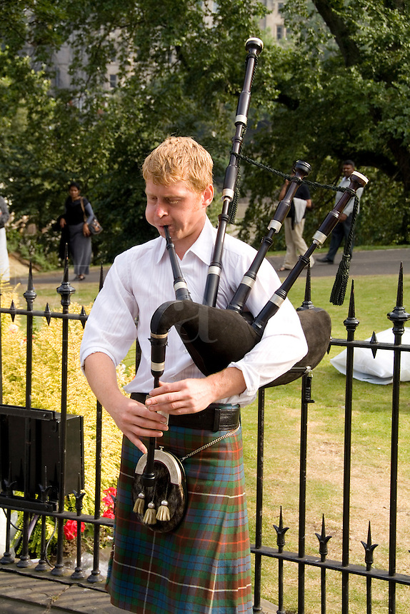 Man playing bagpipes, Edinburgh, Scotland