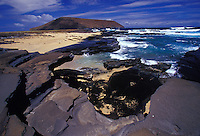 Niihau Coastline. Pristine natural coast, white sand beaches,  reefs, and clear blue water.