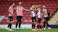 Brentford players congratulate Bryan Mbeumo (No 19) after scoring their third goal during Brentford vs Swansea City, Sky Bet EFL Championship Play-Off Semi-Final 2nd Leg Football at Griffin Park on 29th July 2020